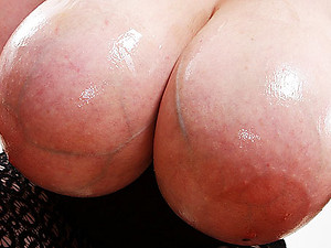 chubby milf shows her oiled monsters